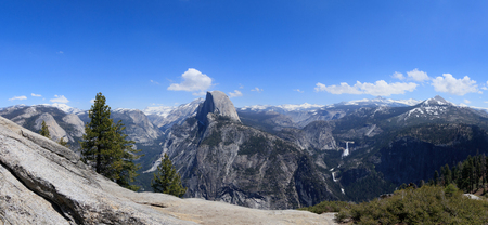 Panorama view of Half Dome. It is a granite dome in Yosemite National Park, California. Landmark of Yosemite NP. View from Glacier Point