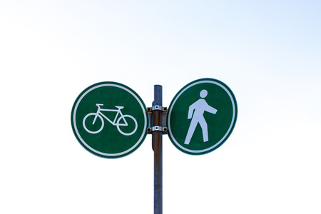 Bike and walking lane sign at Stanley Park and seawall in Vancouver, Canada.