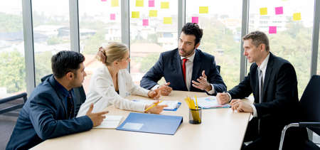 Group of business people are working together and discussing about the project in the meeting room at the office. They are sharing the idea Stock Photo