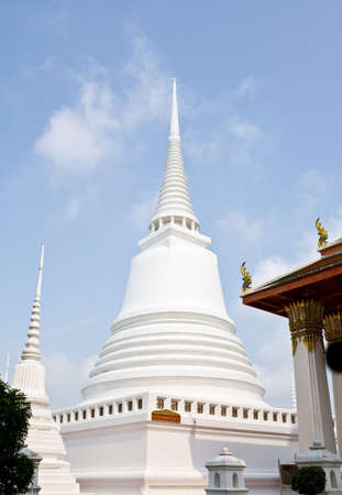 stucco white pagoda near the historic church photo