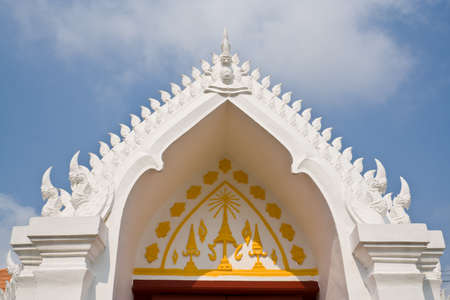 comely: Arch decorated with white naga statue Stock Photo