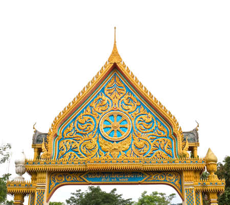 Thai carvings on the gate of the temple photo