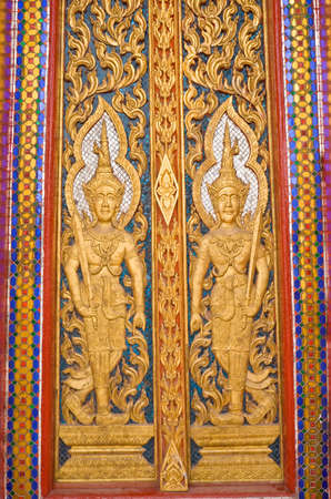 Doors ancient carvings of ancient temples in Thailand photo
