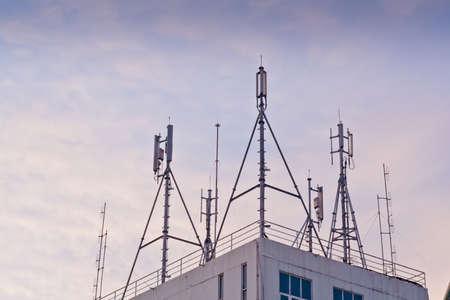 telco: Phone antenna mounted atop a building. Stock Photo