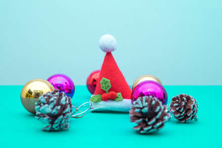 Christmas ornament balls and santa hat with copy space.Christmas deco concept for background.
