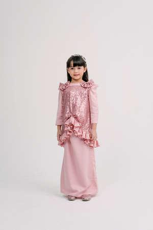 Beautiful female model wearing Baju Kebaya during Eid Celebration.