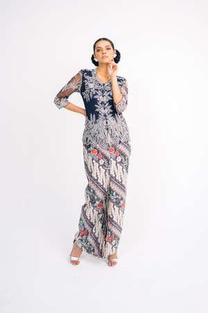 Model with Malaysian traditional cloth for Eid celebration. Reklamní fotografie