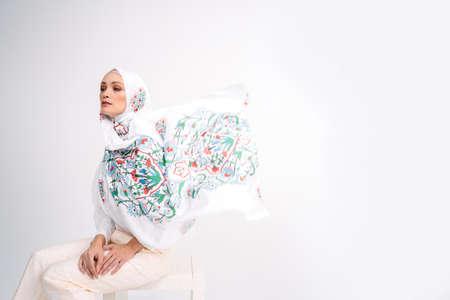 Beautiful Arab Female model wearing hijab isolated over white background.Close up shot.Hijab Fashion.