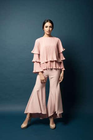 Beautiful middle east female model wearing casual yet elegant cloth.Studio shot.Professional model. Фото со стока