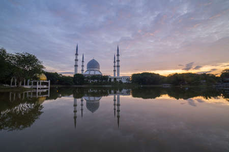 Blue Mosque also known as Sultan Salahuddin Abdul Aziz Shah Mosque during glorious sunrise.