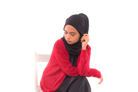 Hijab Fashion.Young Muslim female model wearing hijab.Studio shot.