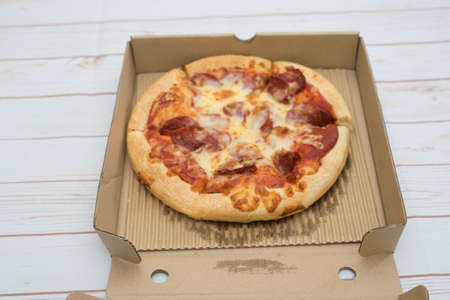 Pepperoni pizza in the box view from top.