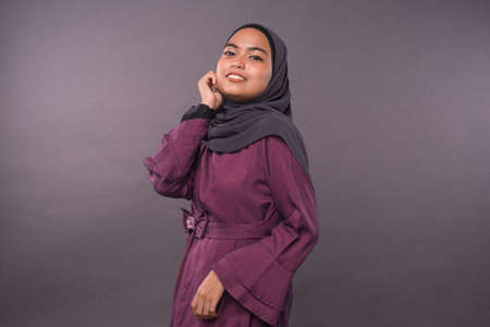 Portraiture of Muslim teenager female wearing hijab.Studio shot.