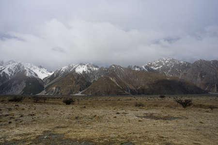 Mount Tasman view from dried field after winter season. Фото со стока