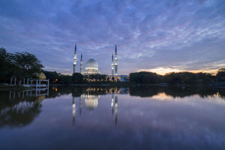 Blue Mosque also known as Sultan Salahuddin Abdul Aziz Shah Mosque during glorious sunrise.