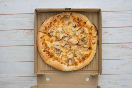 Hawaiian Tuna pizza in the box. Фото со стока