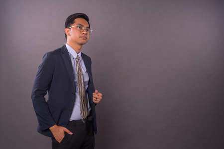 Confidence young intrepreneur or business man with copy space.Studio shot.