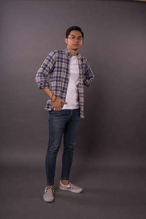 Portraiture of Asian boy with casual out fit.Studio shot.