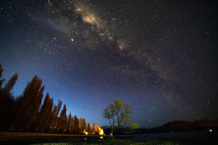 Amazing view of milky way over the mountains and lake in New Zealand.Image contains NOISE due to low light and slow shutter shot.
