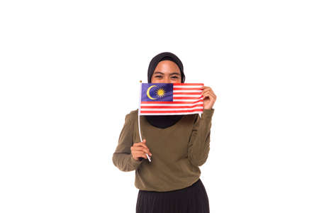 Happy young Malaysian girl holding Malaysia Flag isolated over white background.Independence Day concept.