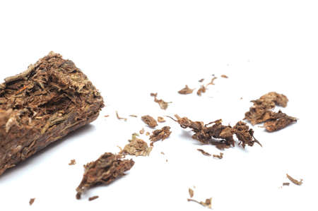 Compacted dried marijuana isolated over white background. Standard-Bild