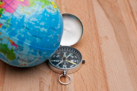 Travel concept.World Globe and compass on the wooden table.