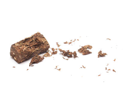Compacted dried marijuana isolated over white background.