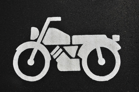 symbol on road is motorcycle photo