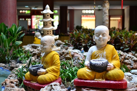 Earthenware of little Buddhist monk. photo