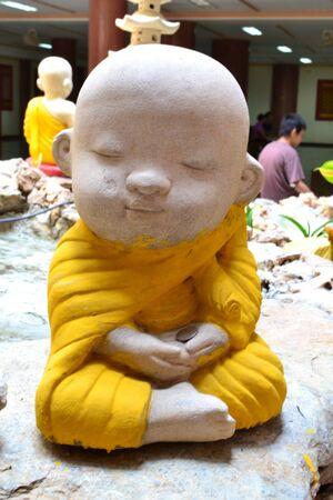 Earthenware of little Buddhist monk. Stock Photo - 13631941