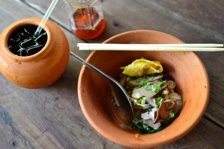 Thai noodle soup in Clay bowl. photo