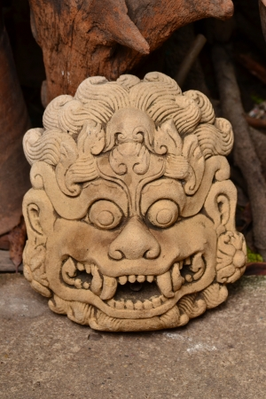 Demon mask sculptures