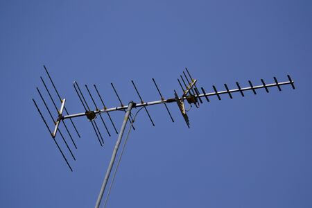 antennae: Television antenna on blue sky. Stock Photo