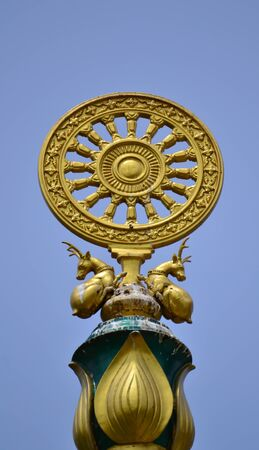 Golden Wheel of Dharma in Thai temple,Thailand,Asia. photo