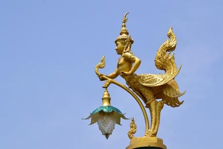 Golden kinnon statue inThai temple,Thailand,Asia. photo