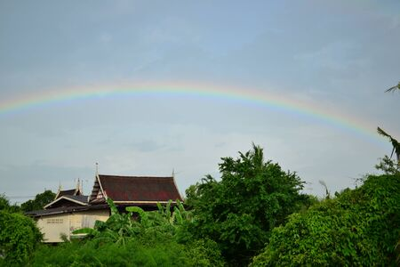 Rainbow above roof photo