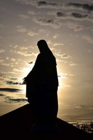 Silhouette  Virgin mary statue in thailand. photo