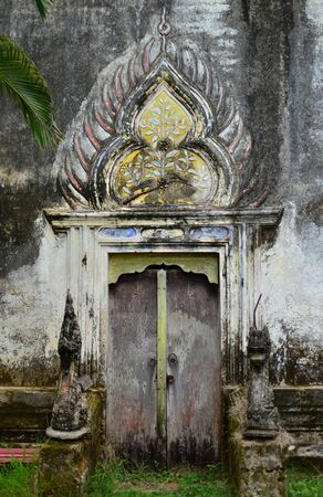 White door of old church(Thai temple),Thailand,Asia photo