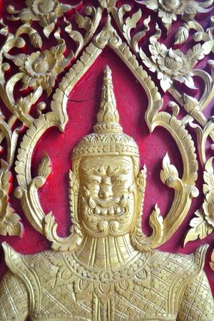 Lai Thai carved on the Thai temple . photo