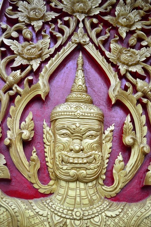 Laithai carved on the Thai temple . photo