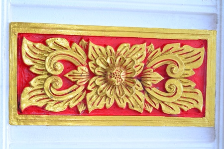 Laithai carved on the Thai temple . photo