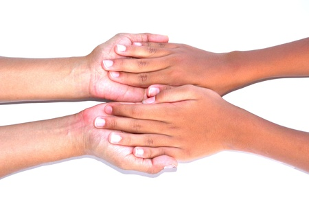 Hand in hand on white background photo