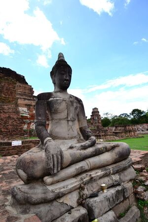 Ancient pagoda and Statue of  Buddha  at Wat Mahatat, Ayutthaya ,Thailand. photo