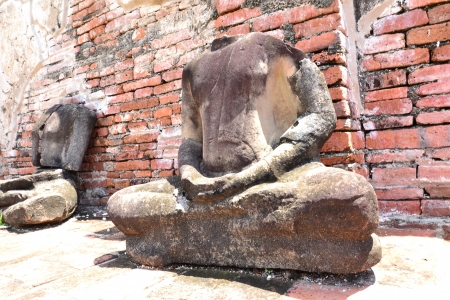 The remains of Buddha at Wat Mahatat, Ayutthaya, Thailand photo