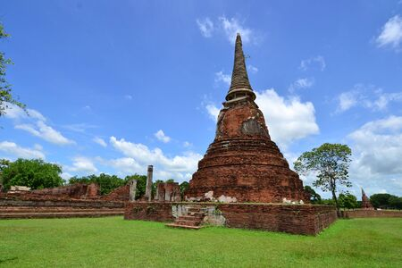 Ancient pagoda of Ayuthaya  with blue sky background, Wat Mahatat, Ayutthaya Thailand. photo