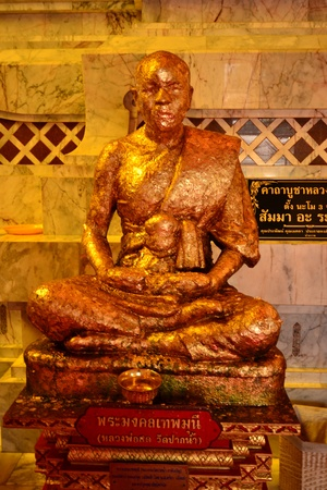 Golden monk  statue photo