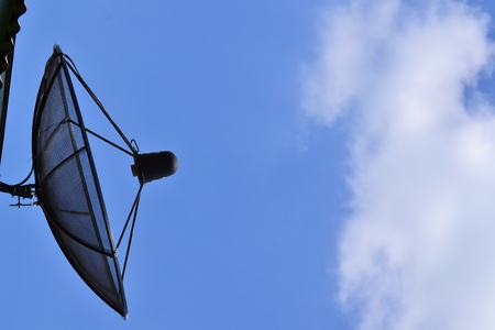 Satellite dish antennas with blue sky photo