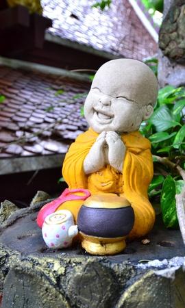 Earthenware of little Buddhist monk.
