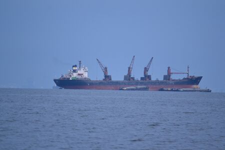 Cargo ship at Si Chang Island,Chonburi Province,Thailand,Asia photo