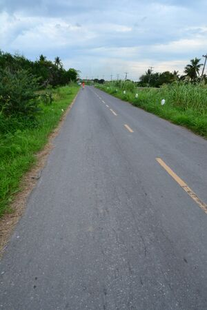 Empty curved road in countryside,Thailand